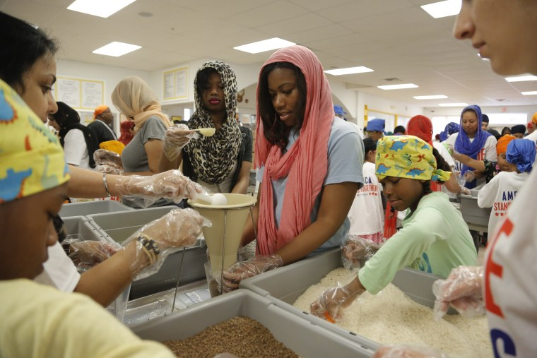 Image: 175 sevadaars in Detroit, Michigan, partnering with Kids Against Hunger, packed over 20,000 meals for the 2014 National Day of Seva.