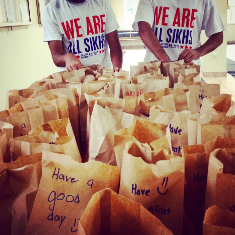 Image: Houston sevadaars packed meals for the homeless for the 2014 National Day of Seva.
