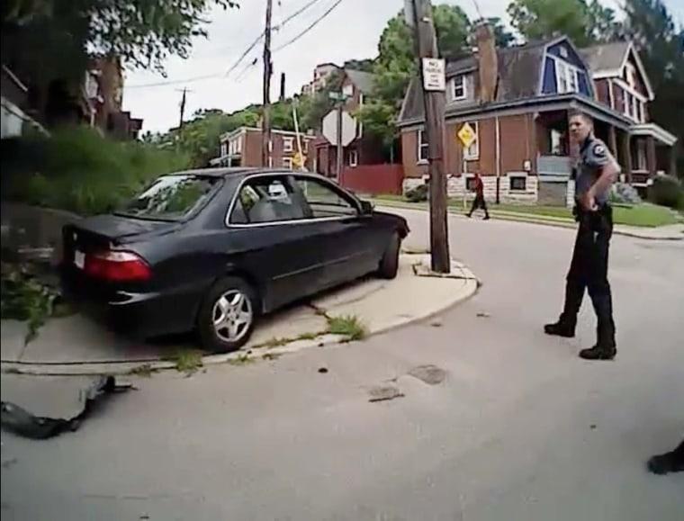 Image: Body cam video shows University of Cincinnati police officer Ray Tensing standing near Dubose vehicle in Cincinnati