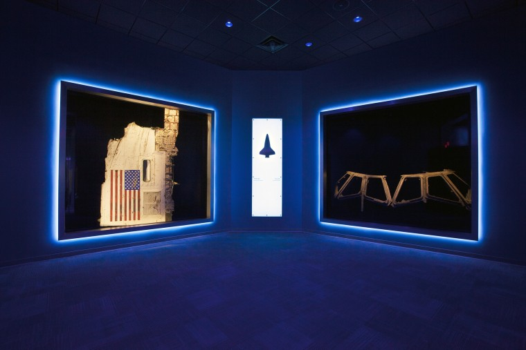 """A section of the fuselage recovered from space shuttle Challenger and the flight deck windows recovered from space shuttle Columbia are part of a new, permanent memorial, """"Forever Remembered,"""" opening June 27 in the Space Shuttle Atlantis exhibit at the Kennedy Space Center Visitor Complex in Florida."""