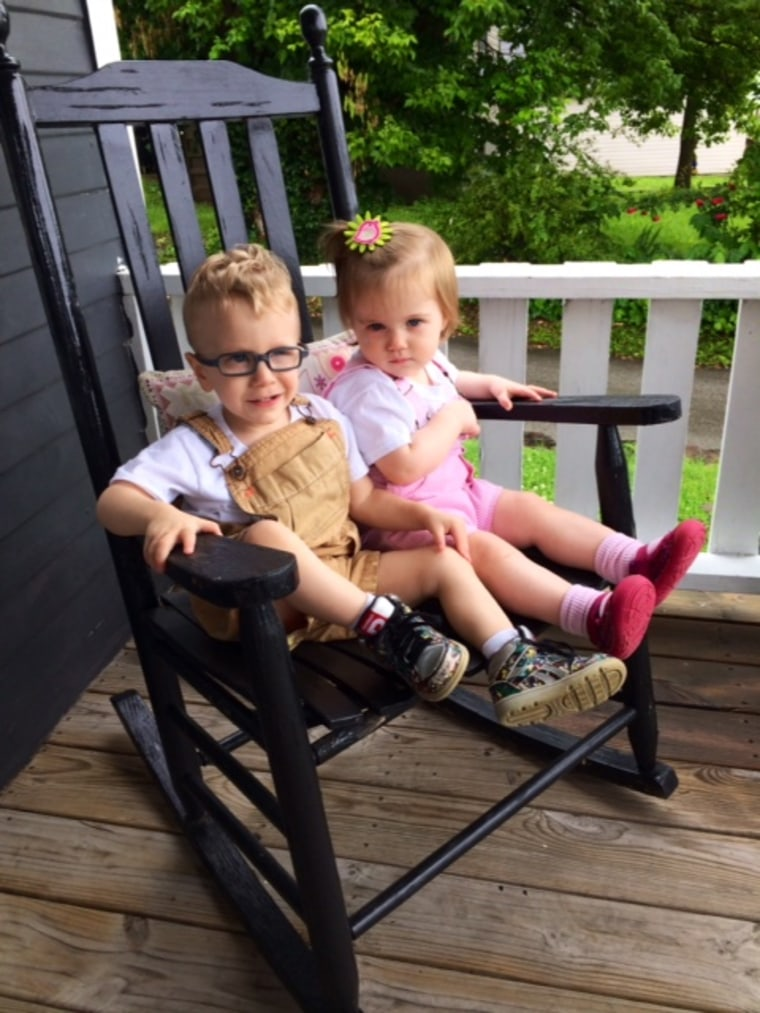 Two toddlers in a chair