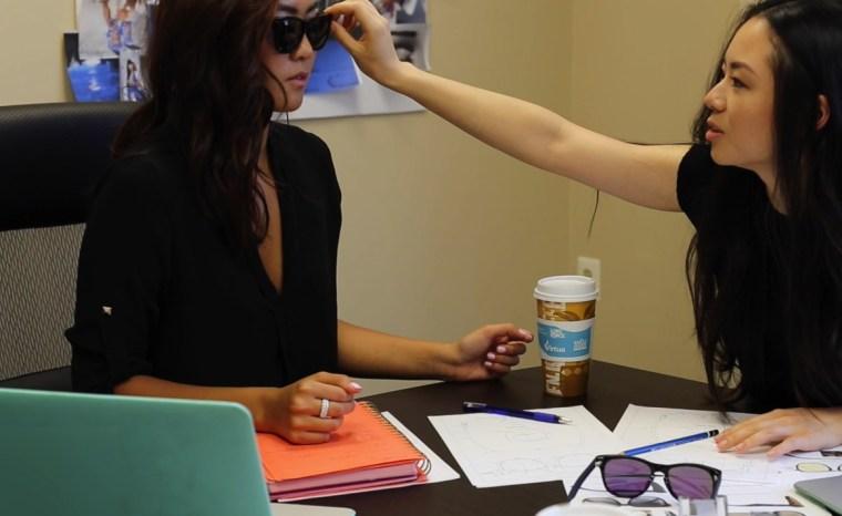 Florence Shin, 24, and Athina Wang, 25, designing and testing a sunglasses.
