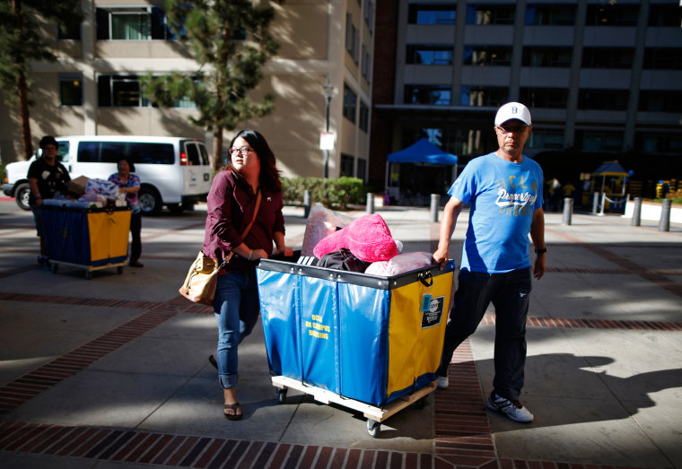 Image: A freshman moves into her UCLA dorm with the help of her father
