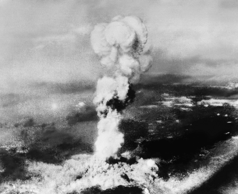 Image: Smoke rises from the explosion of the atomic bomb at Hiroshima, Japan, on Aug. 6, 1945