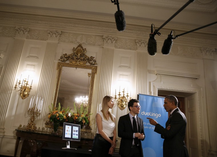 Image: President Obama meets Von Ahn and Gotthilf of Duolingo as he views exhibits at the White House Demo Day at the White House in Washington