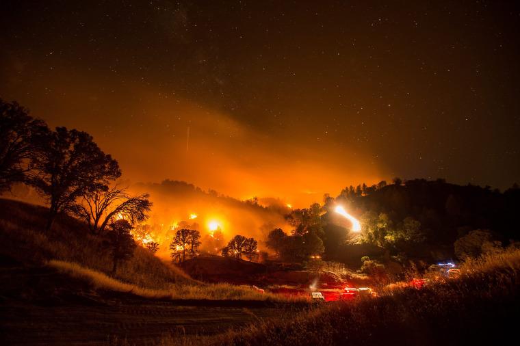 Image: Firefighters use a backfire to battle the Rocky fire near Clearlake Oaks, Calif.
