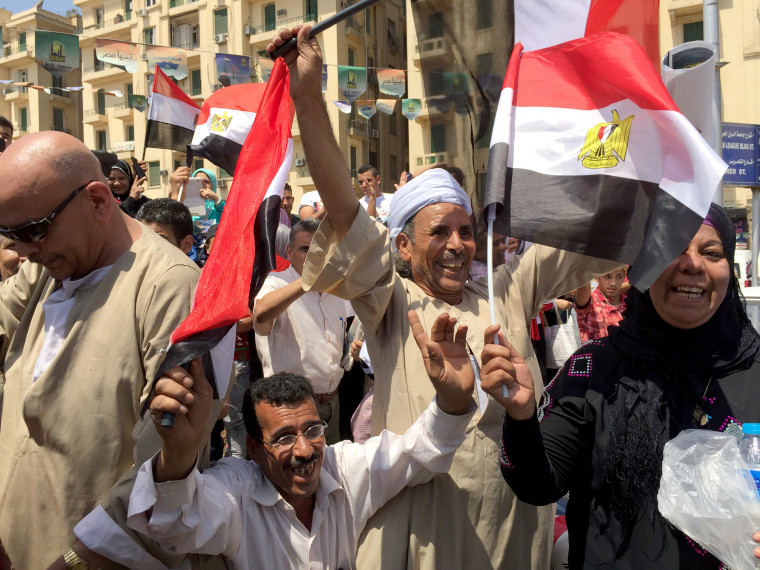 Image: Egyptians dance in tahrir square to  celebrate canal opening