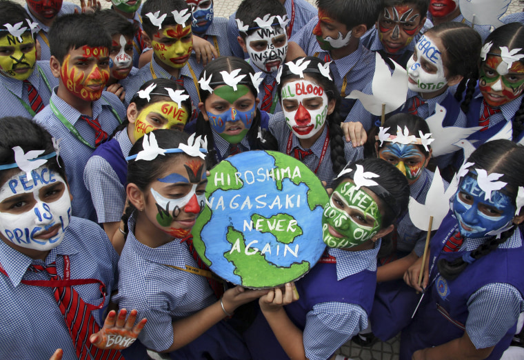 Image: Students pose as they participate in a face-painting event to commemorate the 70th anniversary of the atomic bombings of the Japanese cities in Chandigarh