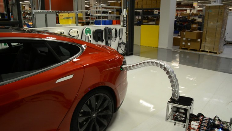 Tesla Shows Off Scary Snake-Like Automatic Charger