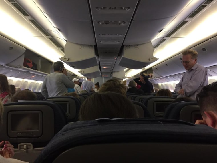Image: Passengers aboard Flight UA935 on August 7, 2015