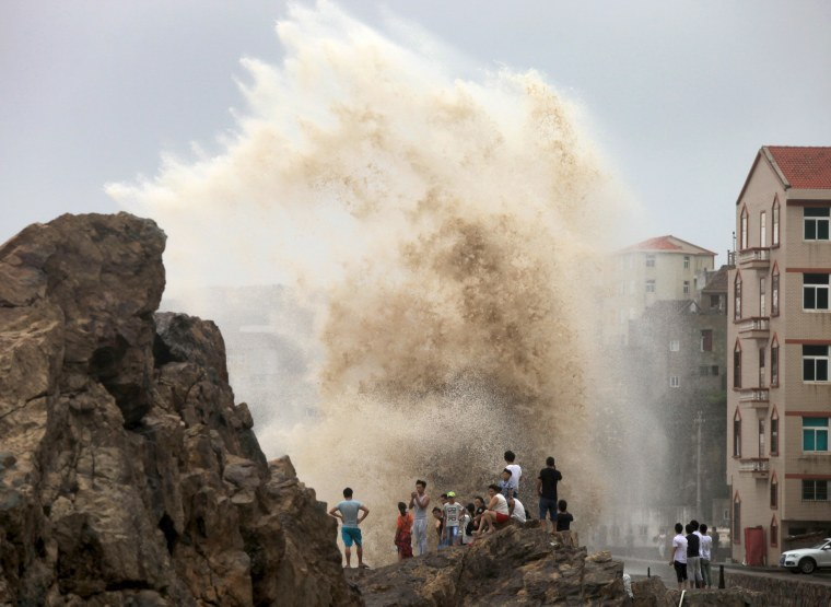 Image: People look at waves as typhoon Soudelor approaches China, in Taizhou, Zhejiang province