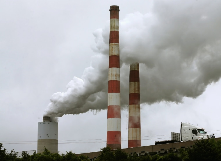 Image: Emissions spew out of a large stack at the coal fired Morgantown Generating Station, in Newburg, Md.