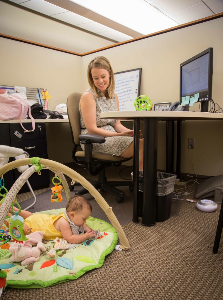 Mom Lindsay Fein, an employee of United Way of Metropolitan Dallas, at work with her newborn.