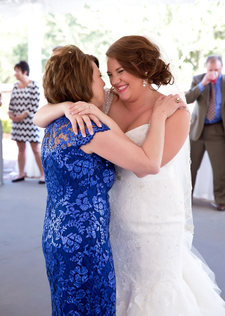 Bride and mom embrace