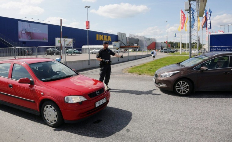 Image: Police outside an IKEA in Sweden where two people were stabbed