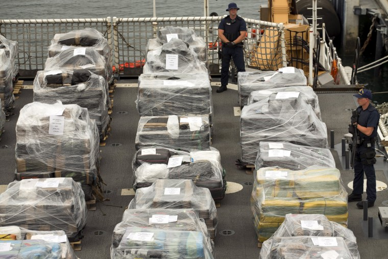 Armed crew members of the U.S. Coast Guard Cutter Stratton keep watch as more than 66,000 pounds of cocaine worth $1.01 billion wholesale that was seized in the Eastern Pacific Ocean is unloaded upon arrival in San Diego, California August 10, 2015.