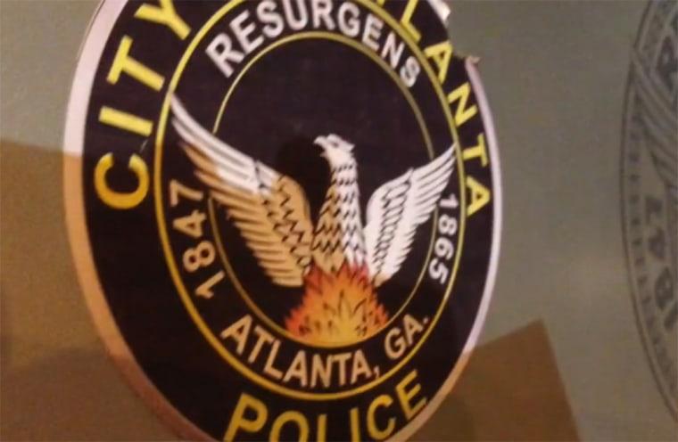 Image: An Atlanta Police logo is seen