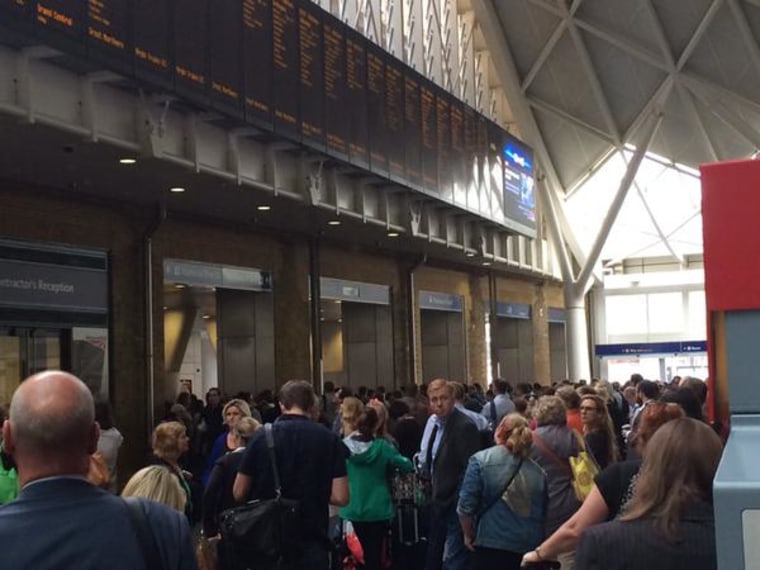 """Sea of people stuck at #KingsCross due to a """"security incident"""". Platforms closed and lots of armed police!"""