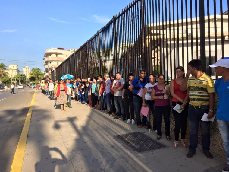 Image: Cubans in line outside the U.S. Embassy in Havana Thursday.