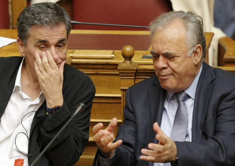 Image: Greek Finance Minister Tsakalotos and Deputy Prime Minister Dragasakis attend a parliamentary session in Athens
