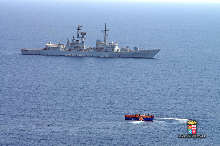 Image: A handout picture from the Italian navy shows a previous rescue last week.