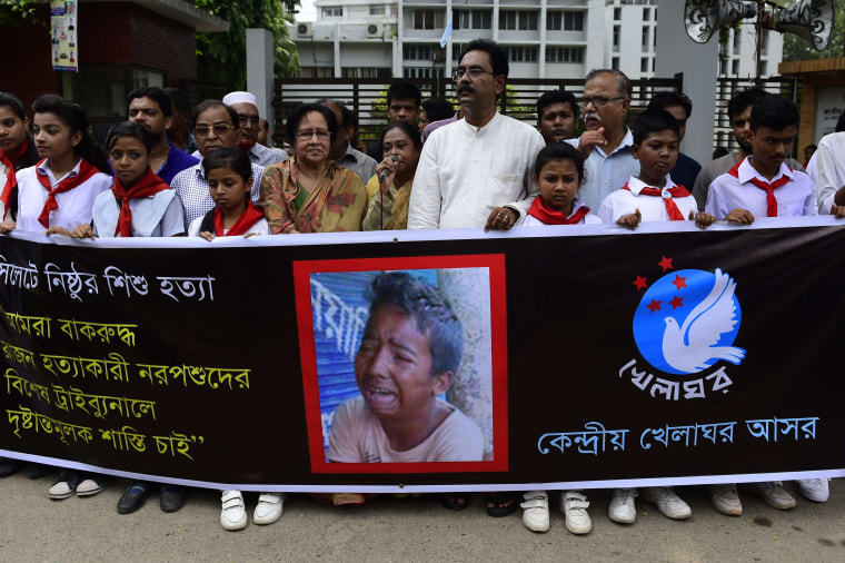 Bangladeshi protesters carry a banner during a demonstration against the lynching of a 13-year-old boy in Dhaka on July 14, 2015.  Outrage over the lynching of a 13-year-old boy mounted in Bangladesh July 14, 2015, with more protests over the murder which was captured on video, as one of the suspects confessed after being arrested in Saudi Arabia. Bangladeshi police have now arrested five people over the July 8 killing of Samiul Alam Rajon, who was tied to a pole and then subjected to a sickening assault in which he pleaded for his life.