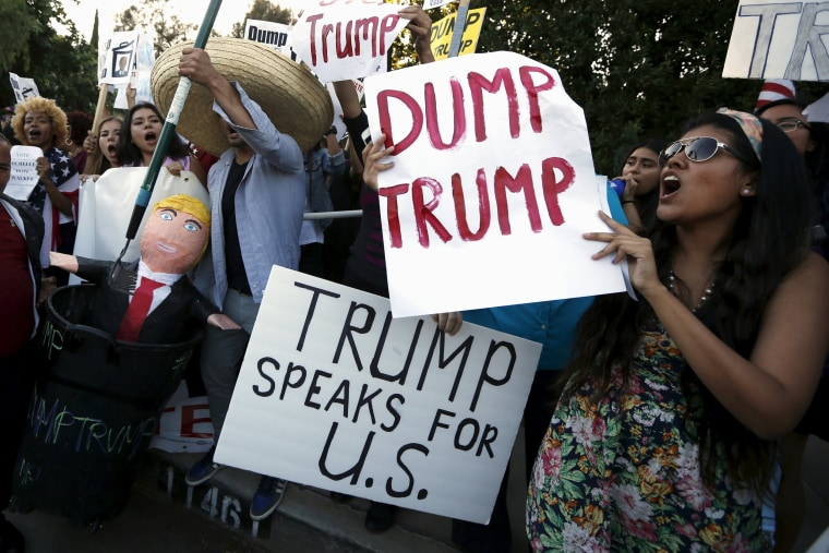 Image: Protesters and supporters stand outside the Luxe Hotel, where Republican presidential candidate Donald Trump was expected to speak in Brentwood, Los Angeles