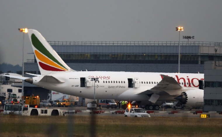 """In this July 2013 photo, a general view of the Air Ethiopian Boeing 787 Dreamliner 'Queen of Sheba' plane on the runway near Terminal 3, at Heathrow Airport, London. U.S. aviation officials say they want the emergency locator transmitters on all Boeing 787 """"Dreamliners"""" inspected following a fire aboard the Queen of Sheba that was parked at London's Heathrow Airport."""
