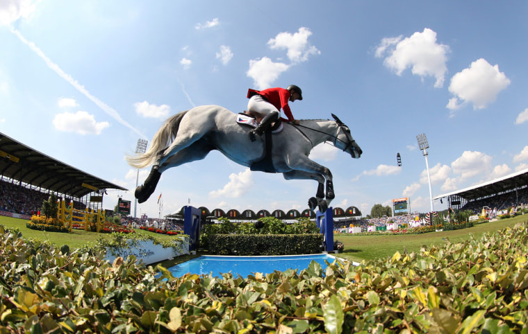 Image: Ondrej Zvara of Czech Republic jumps with his horse Cento Lano over an obstacle