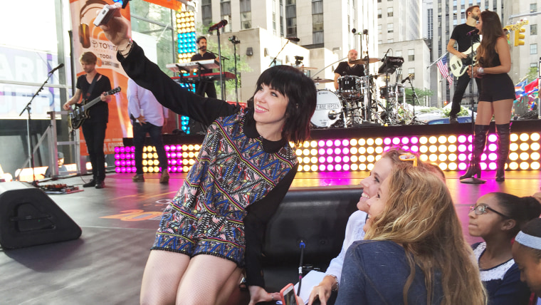 Carly Rae Jepsen takes a selfie with fans on the TODAY Show plaza.