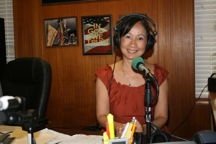MaiLy Do poses inside the Vietnamese-language public radio station she founded in Oklahoma City.