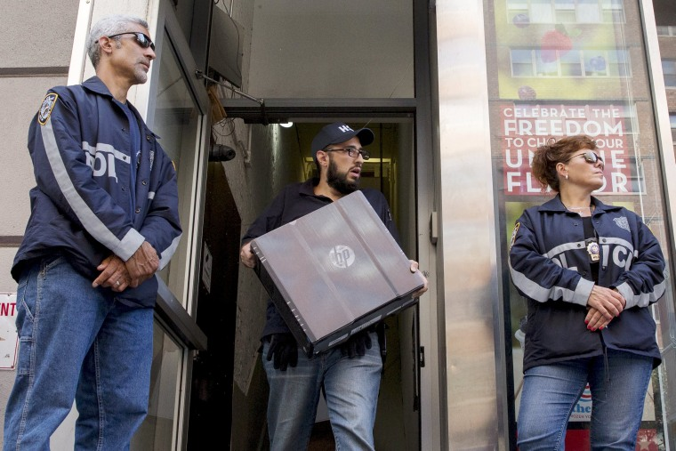 Image: Officers seize evidence from the Manhattan offices of Rentboy.com