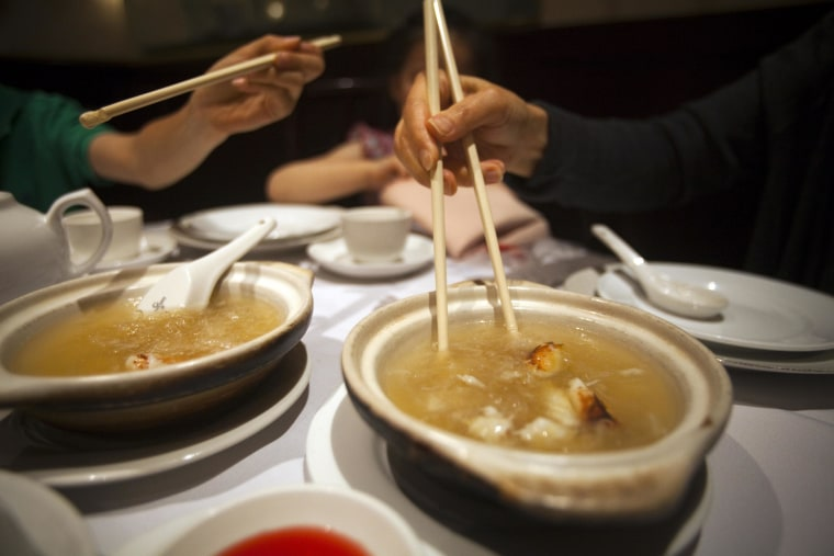 A family eats shark fin soup at Vancouver's Grand Honor Chinese restaurant in Vancouver, British Columbia July 1, 2012.