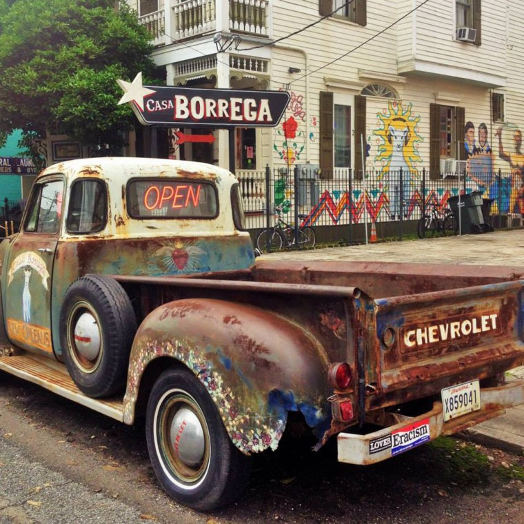 Image: A rusty Chevy truck sits in front of Casa Borrega