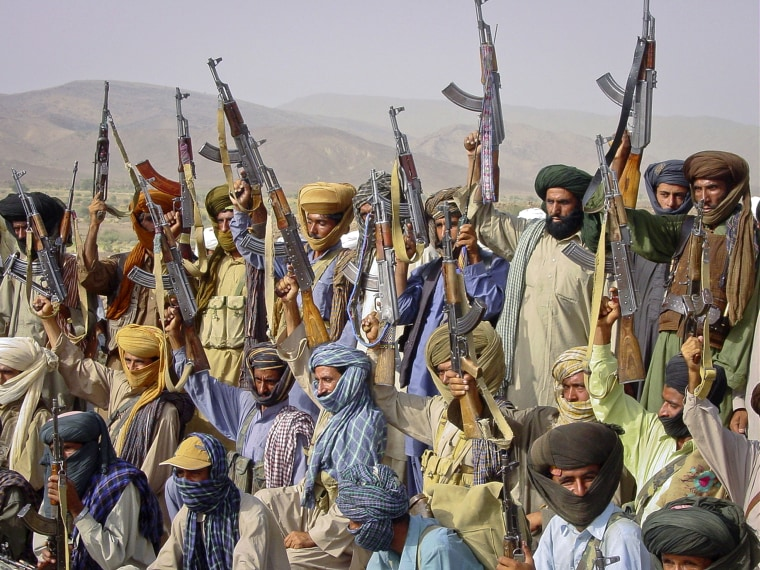 Image: Baloch rebels holding their weapons
