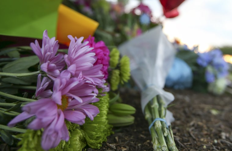 Image: Flowers are seen at a memorial outside of the offices for WDBJ7 where killed journalists Alison Parker and Adam Warm worked in Roanoke