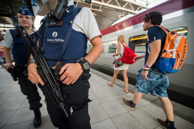 Police officers patrolling platforms at Brussels Midi Station in Belgium.
