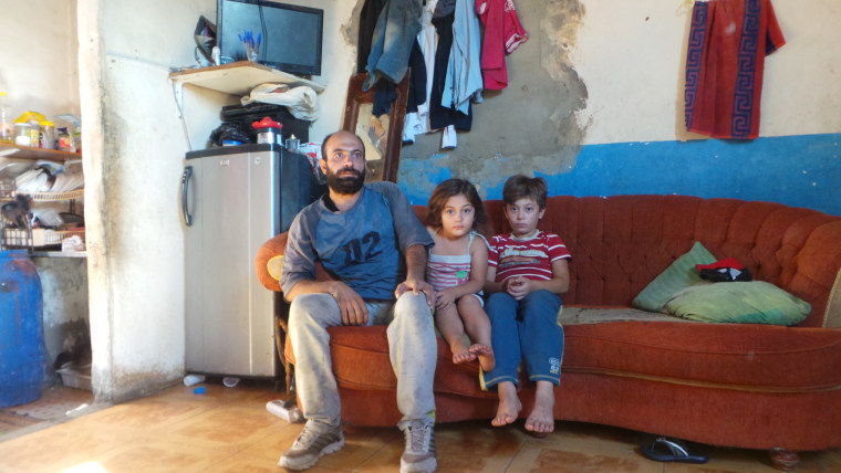 Image: Abdul Halim with daughter Reem, 4, and son Abdalla, 9
