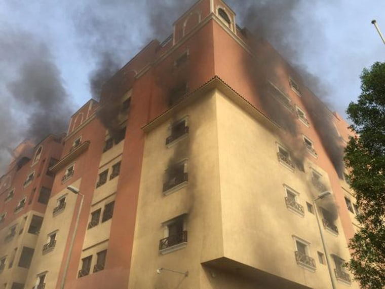 Image: Smoke billows from a fire at a residential complex used by state oil giant Saudi Aramco in Khobar