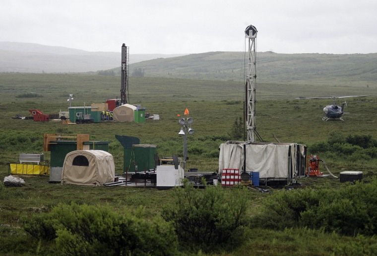 Workers operate a test drill at the Pebble mine project test in the Bristol Bay region of Alaska near the village of Iliamma, Alaska, in 2007.