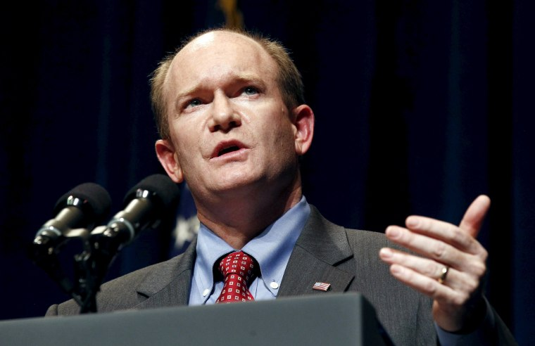 Image: File photo of Senator Chris Coons speaking at a campaign event in Wilmington, Delaware
