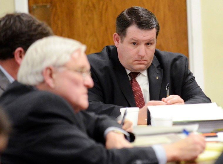 Image: Former Eutawville Police Chief Richard Combs sits with lawyers