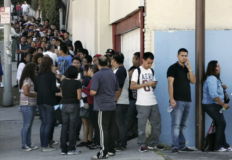 Image: People line up for assistance with paperwork for Deferred Action for Childhood Arrivals program at Coalition for Humane Immigrant Rights of Los Angeles in Los Angeles