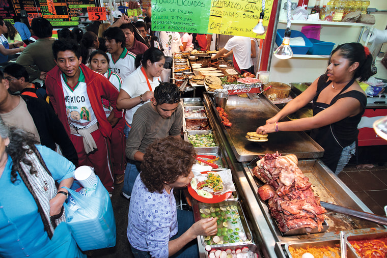 """Mexico City: Bacometro, located just outside the metro stop in the Mercado Merced serves tortas and huaraches all day as hundreds of people pass by, from the book """"Eat Mexico"""" by Lesley Téllez."""
