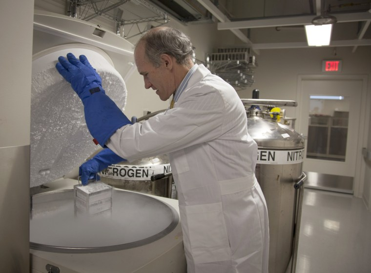 Dr. Carl June, one of the study's leaders, opens a freezer of engineered cells.
