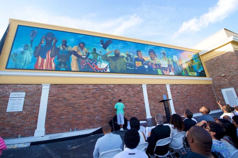 The OneUnited Mural Project and the landmark mural, Thunder & Enlightening, by muralist Addonis Parker