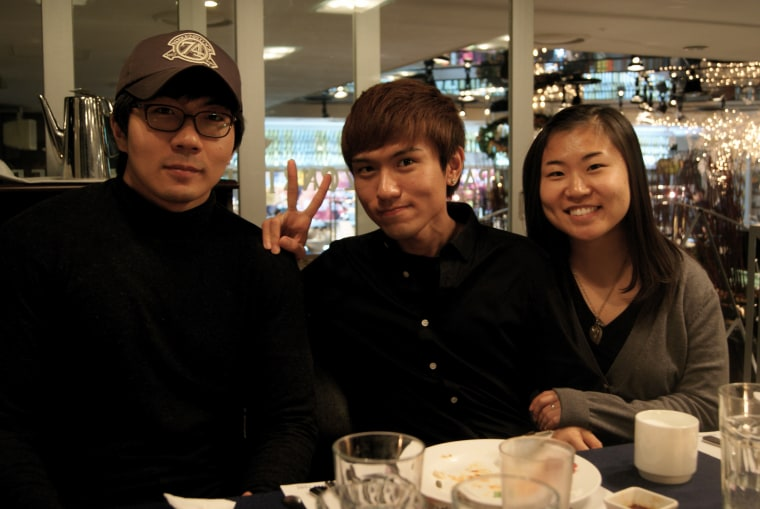 Whitney Fritz (right) and her two siblings go out to eat in Seoul, South Korea in February 2011.