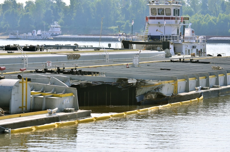 Image: Damage on a barge is seen as it is moored along the Kentucky shore of the Mississippi River