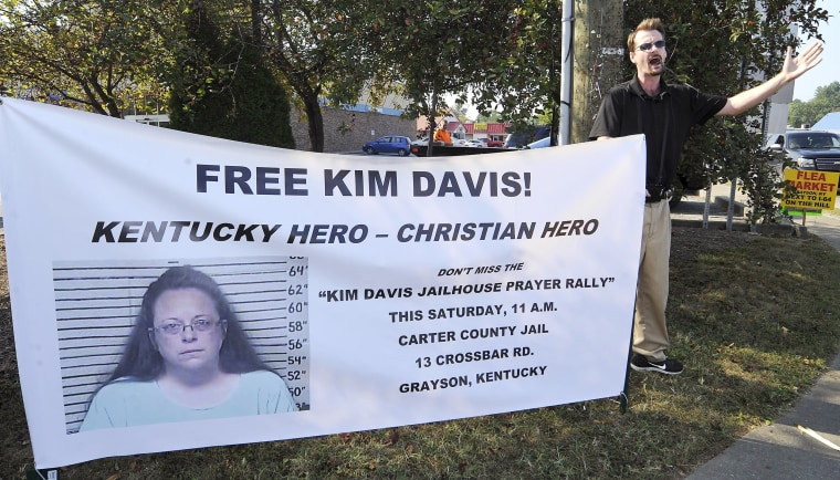 Image: David Jordan, a member of Chirst Fellowship in North Carolina, preaches in support of the prayer rally at the Carter County Detention Center for Rowan County clerk Kim Davis in Grayson