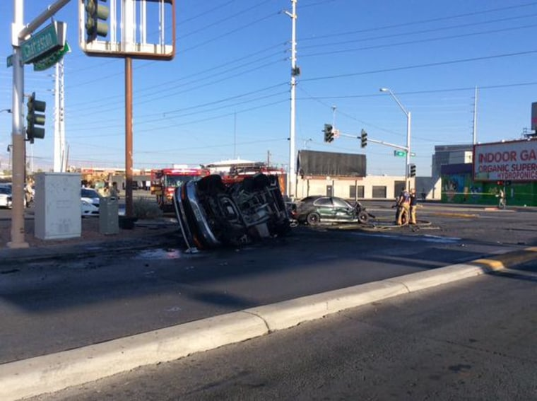 Fire personnel at the scene of the deadly crash at Main Street and Charleston Boulevard in Las Vegas Saturday